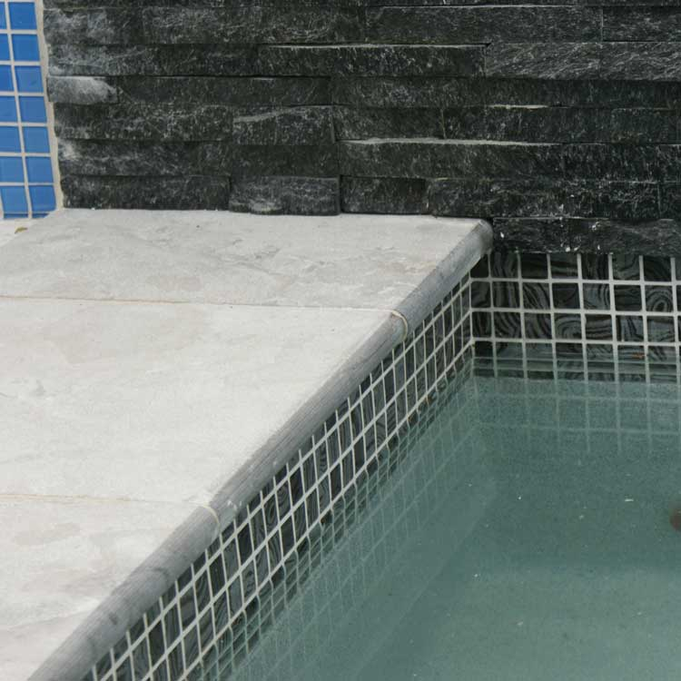 Display Pool 5 - Pewter Limestone Bullnose, Lapis Glow Interior, Obsidian Waterline Tiles, Galaxy Black Stackstone