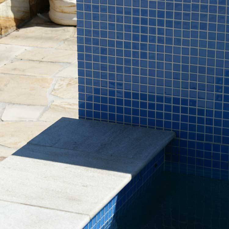 Display Pool 6 - Coconut Ice Quartzite Bullnose, Turquoise Interior, Mid Blue Waterline Tiles